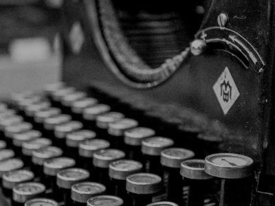 typewriter-407695_1920-e1587390980675-darken